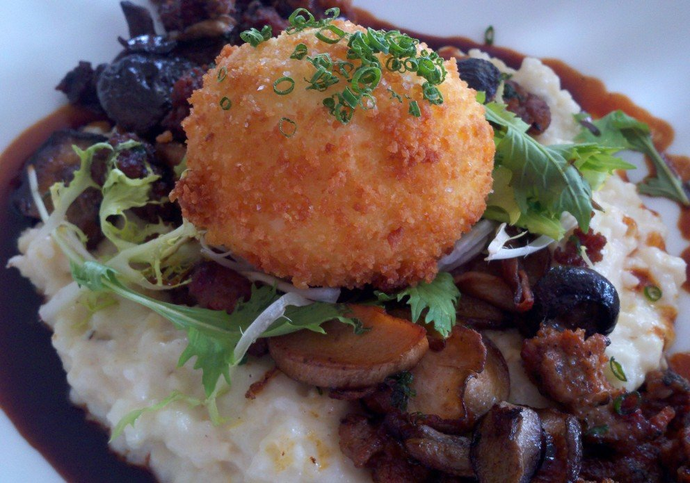 The crispy egg with buttery grits