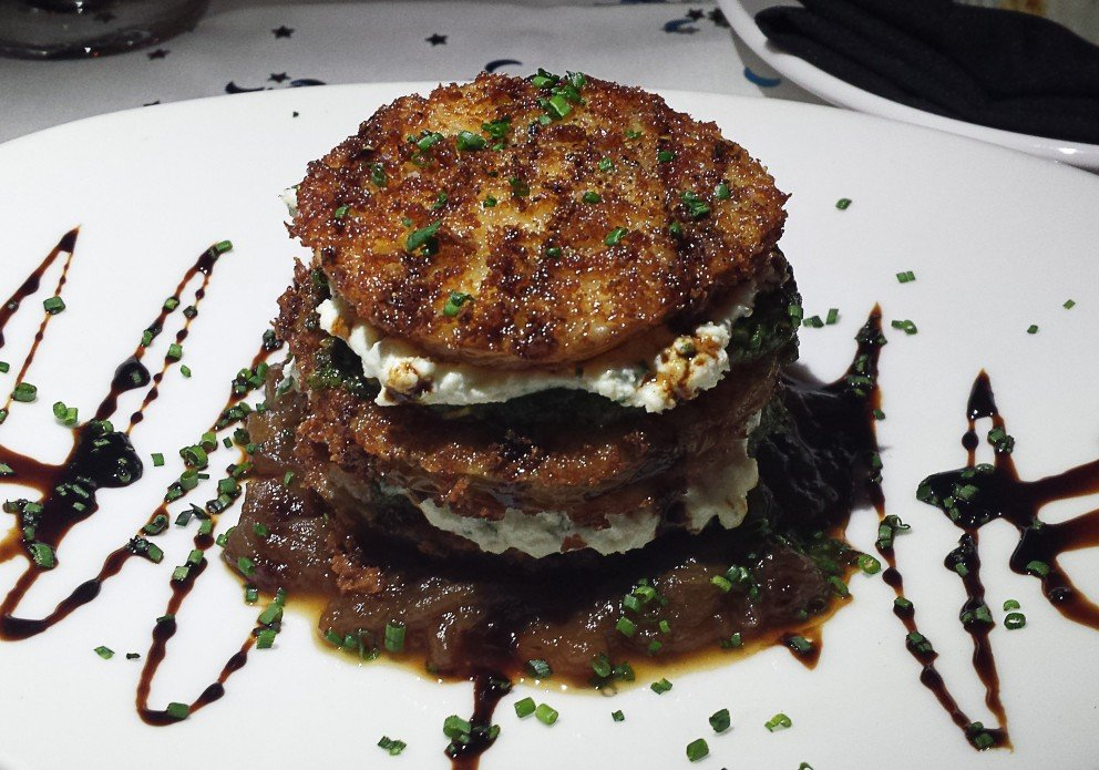 Fried Green Tomatoes with caramelized onions and a balsamic drizz