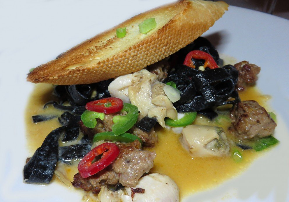 Sausage & clams with serrano chili and squid ink tagliatelle