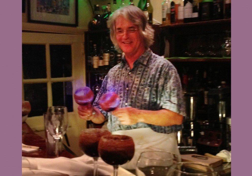 Veteran barkeep Bee Neild with his Flaming Coffee