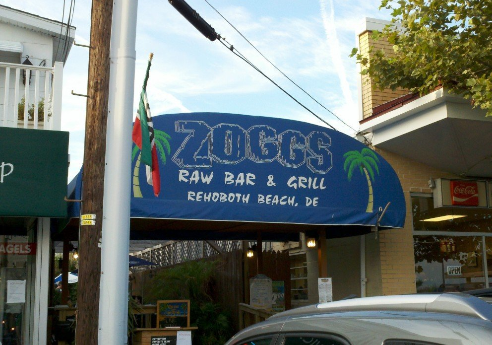 Look for the blue awning!
