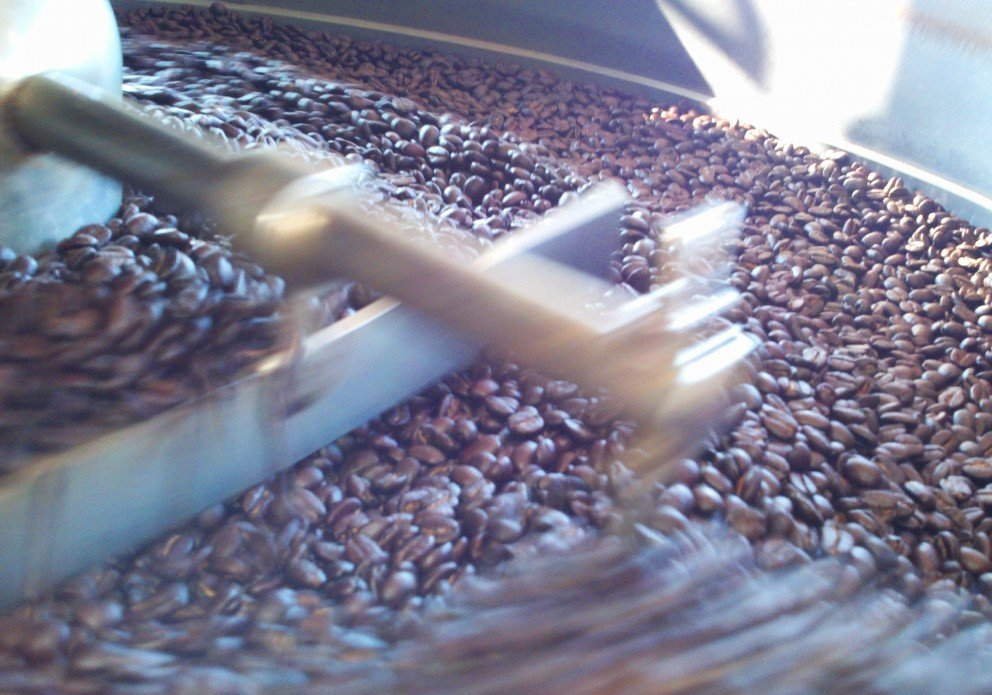 Stirring and cooling the hot coffee beans. You should smell the smell!