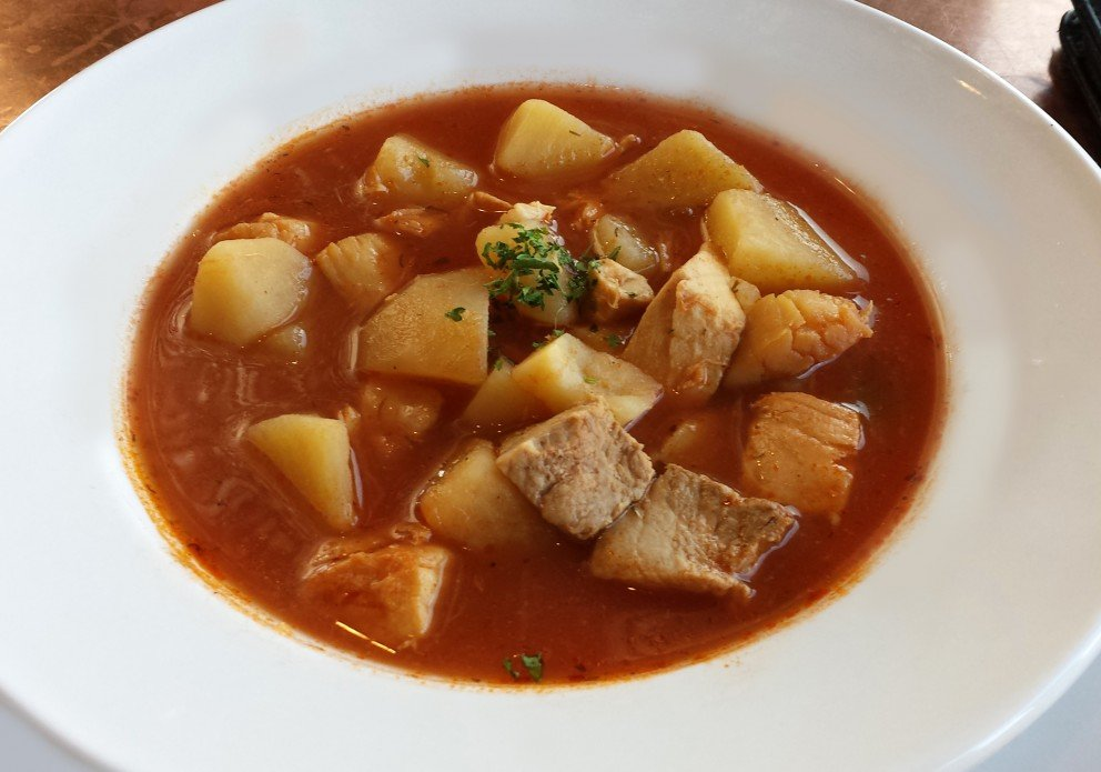 Seafood chowder with LOTS of potatoes.