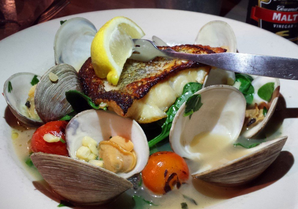 Snow-white cod with clams and spinach