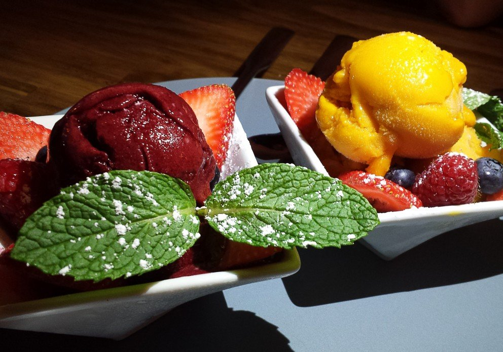 Blackberry/cabernet sorbet and mango gelato laced with fresh strawberries.