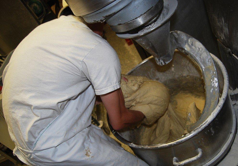 OWB Boy scooping dough crenh