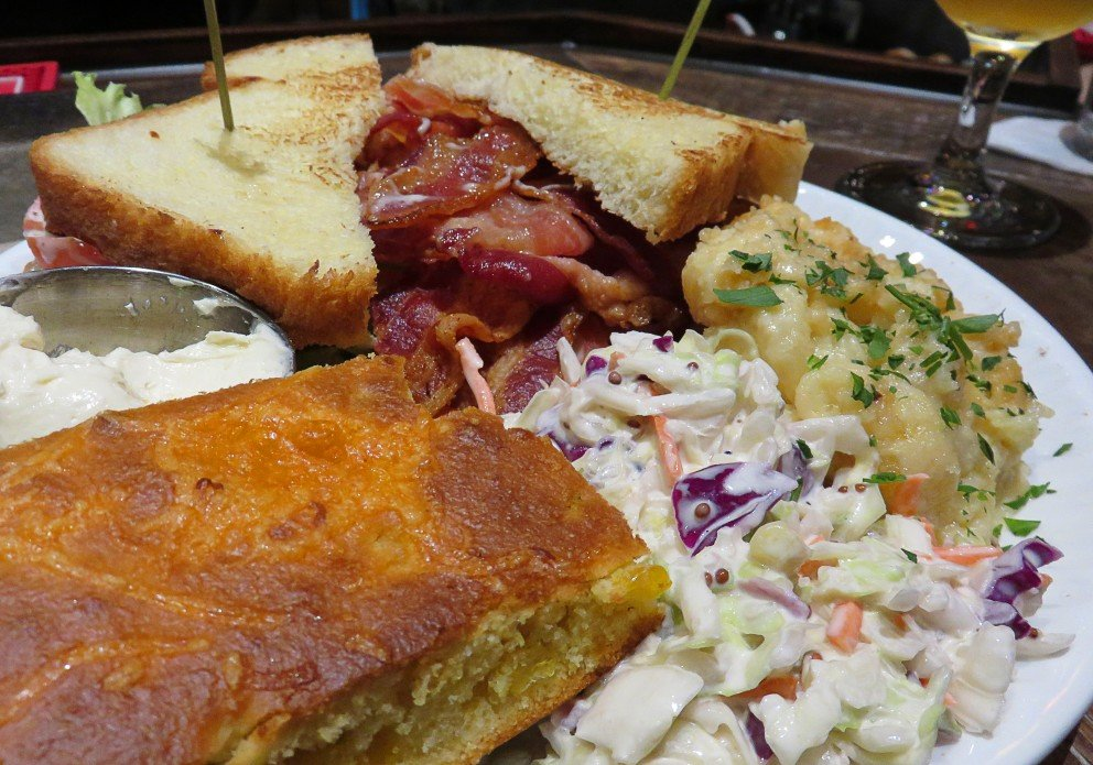 A mountainous BLT with lots of sides