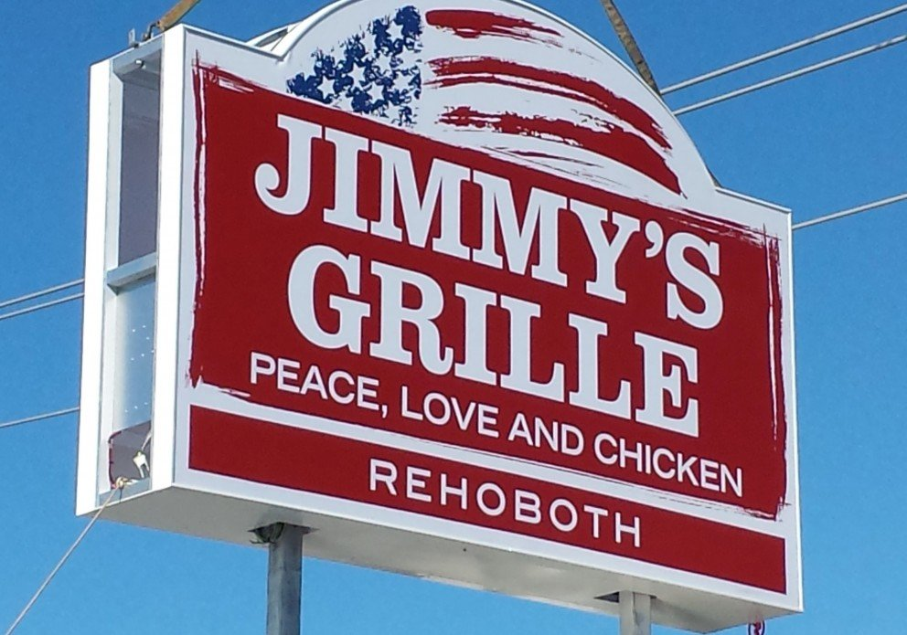 Jimmy's Reho Sign going up closecrenh